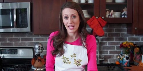Comedian Julianna Jones Wearing Apron in Kitchen