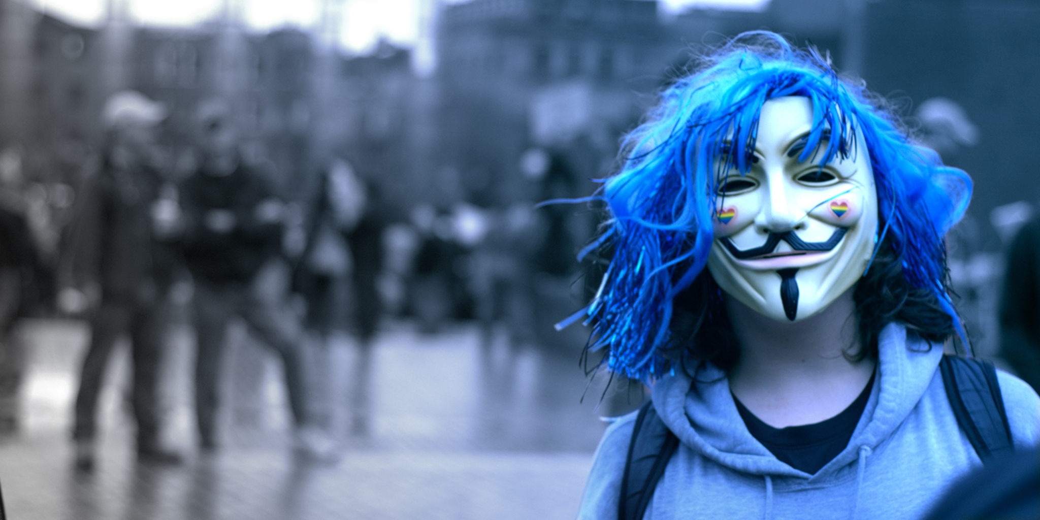 image of someone wearing an anonymous mask