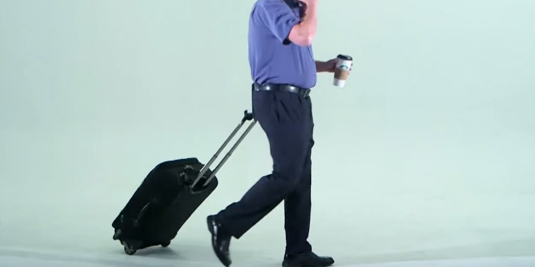 man walking with a suitcase attached to his butt