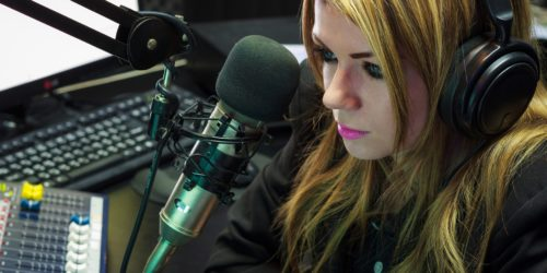 Woman in a podcast studio