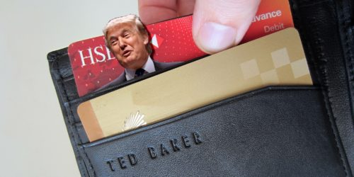 trump popping out of a wallet credit card