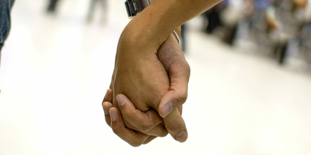 people holding hands