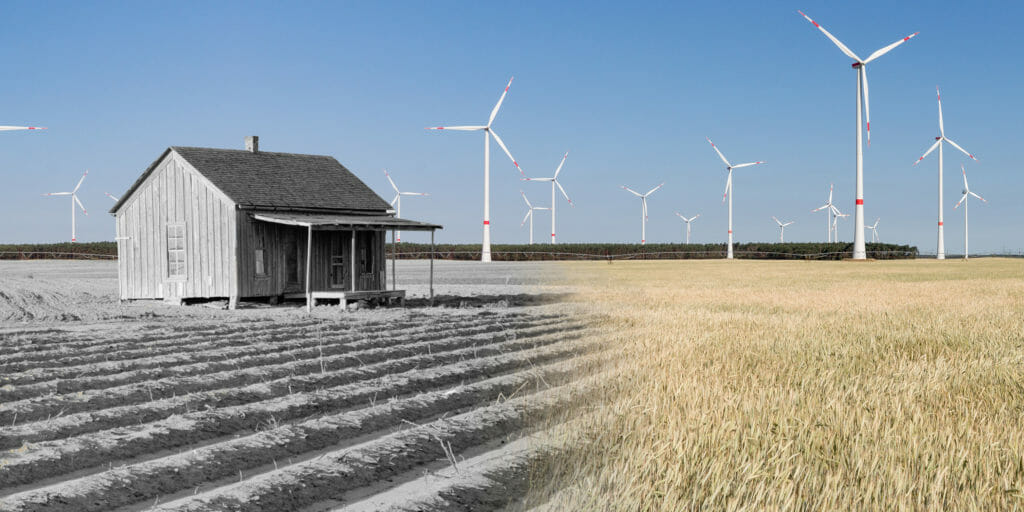 abandoned new deal era farmhouse surrounded by modern windmills