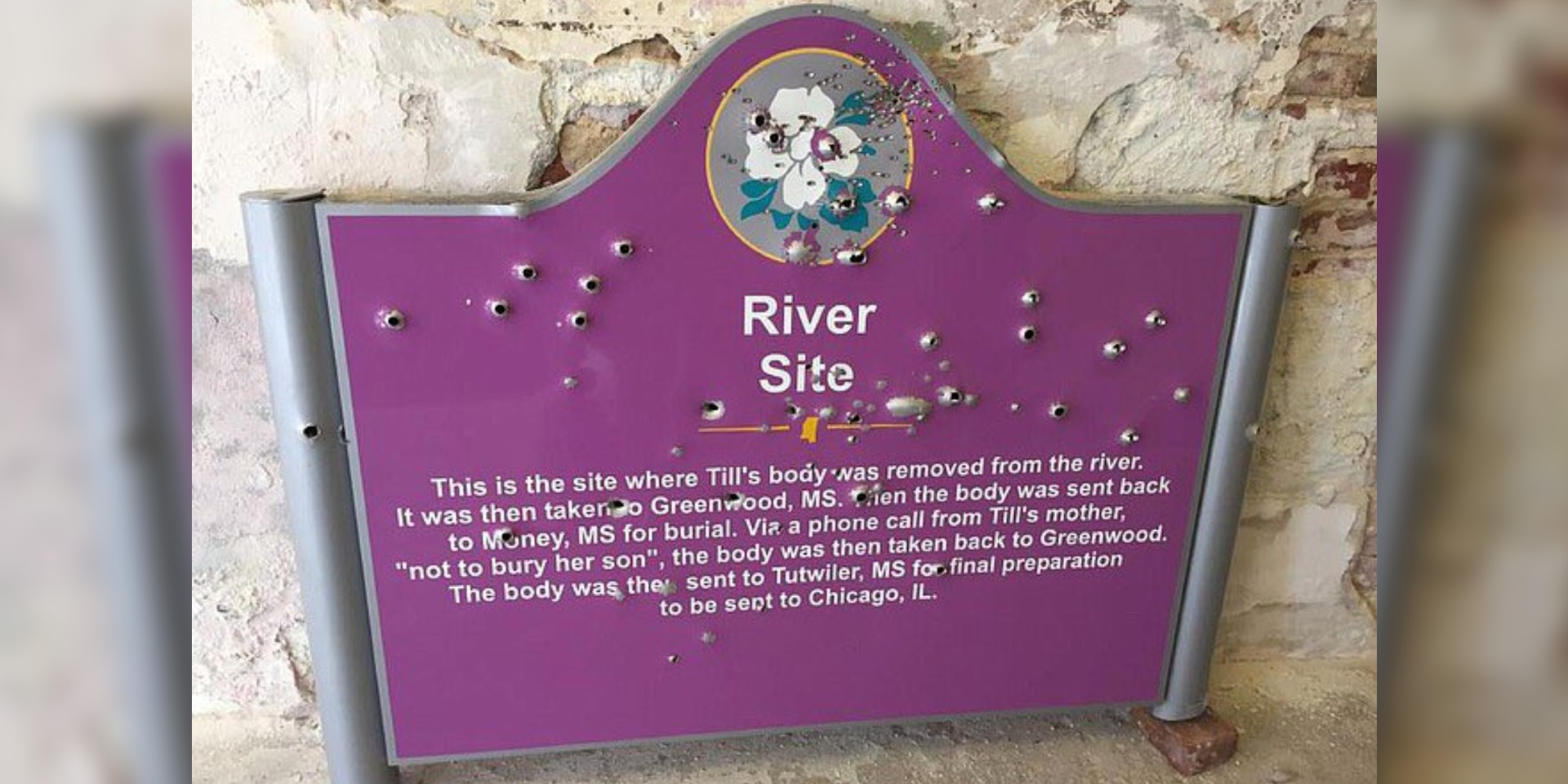 A memorial for Emmett Till shows bullet holes