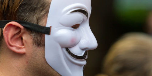 Man wearing a Guy Fawkes mask