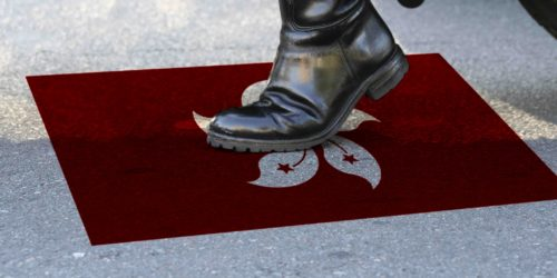 police boot stepping on hong kong flag