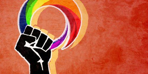 revolution hand holding the GLBT Community Central logo
