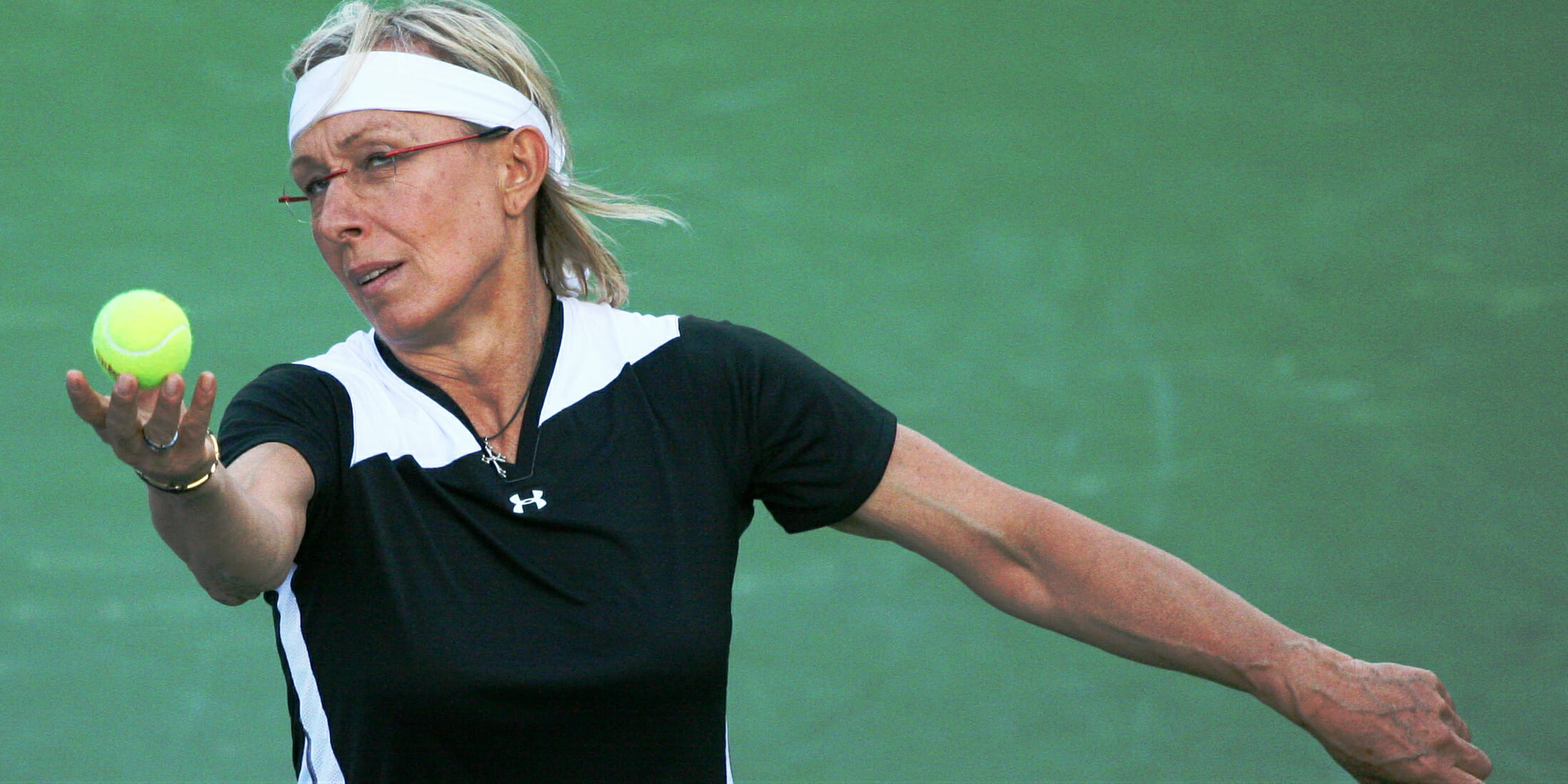 Martina Navratilova alleges an enormous pay gap between herself and commentator John McEnroe.