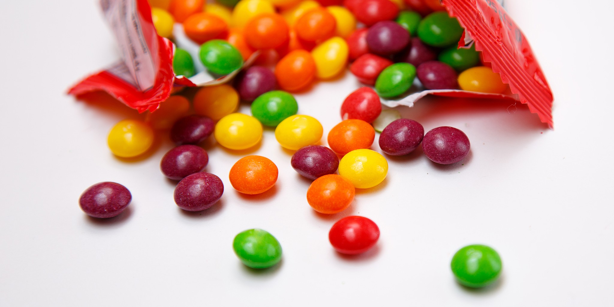 Skittles candy pouring out of a bag