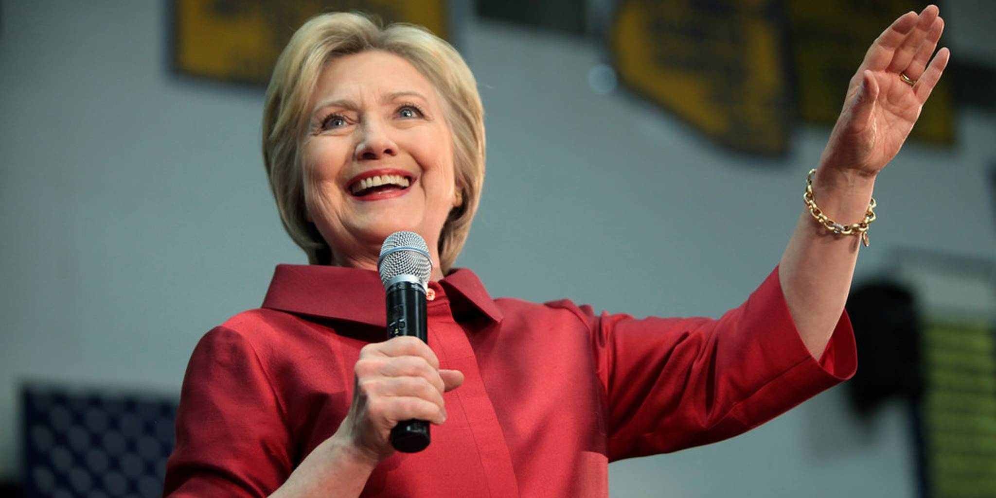 Hillary Clinton holding microphone at rally