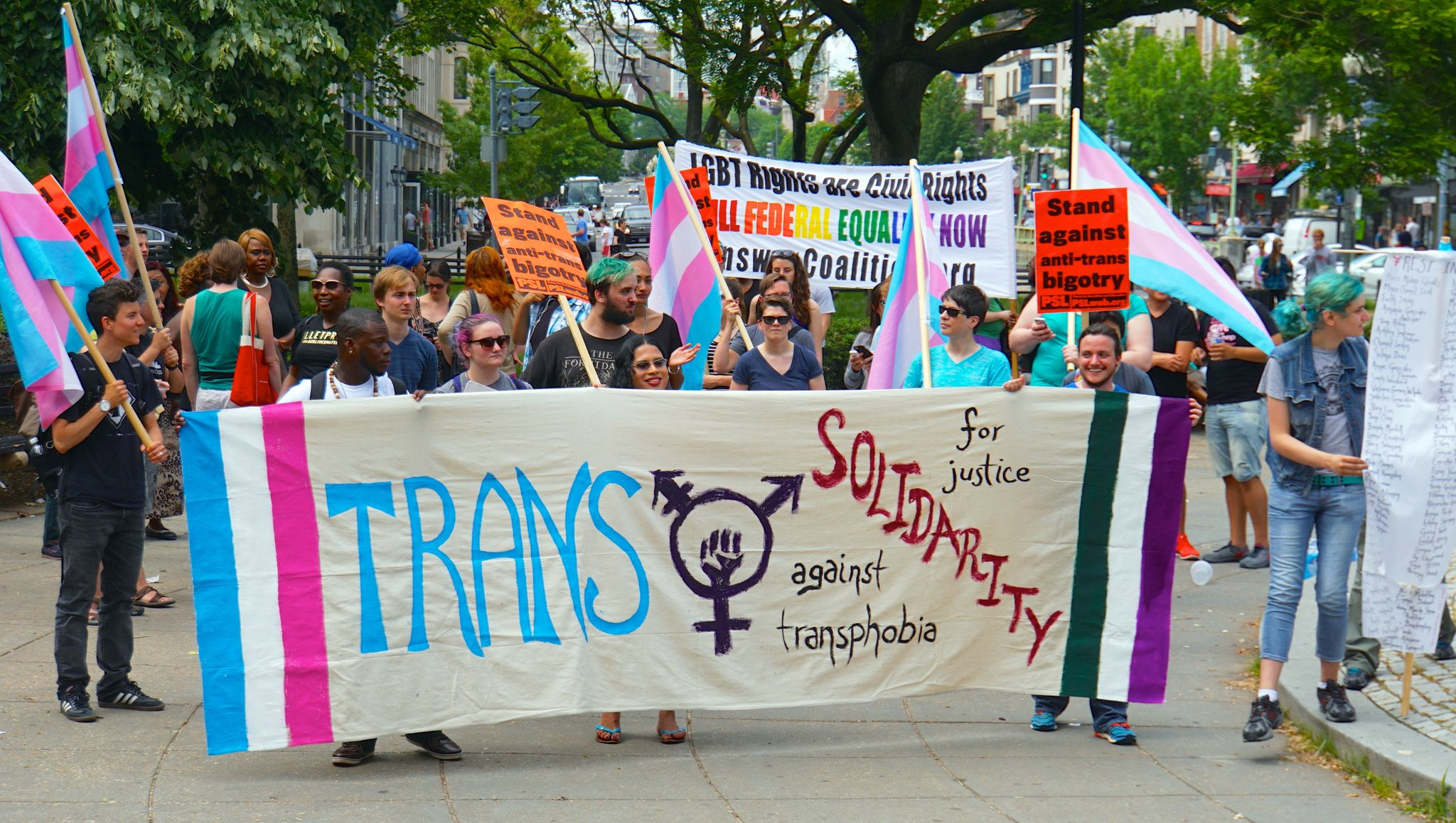 what does transgender mean: transgender solidarity transphobia protest