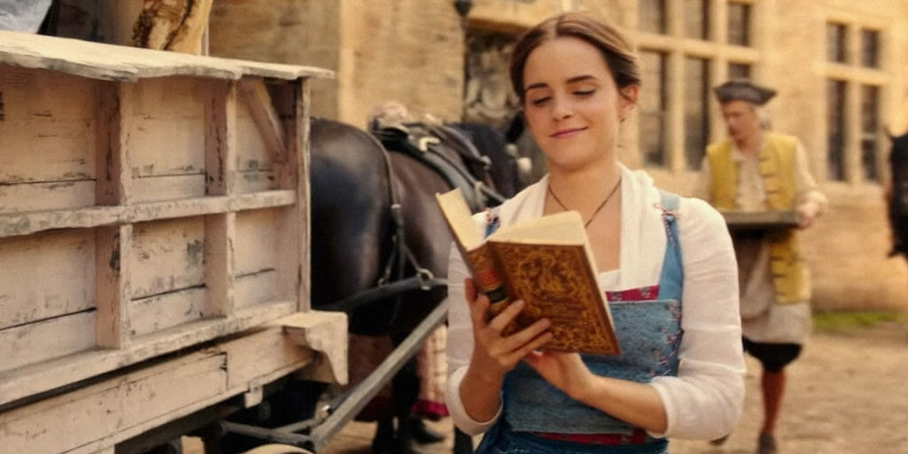 Belle reading a book while walking