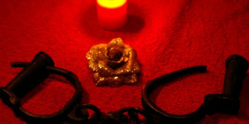 Handcuffs Next to Gold Rose