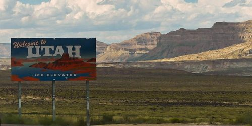 Welcome to Utah sign and landscape