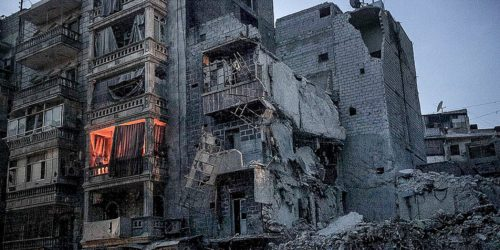 Night falls on a Syrian-rebel controlled area on Sa'ar street. An apartment is illuminated by fire used by one family to keep them warm beside destroyed buildings, among those the Dar Al-Shifa hospital, after airstrikes targeted the area last week, in Ale | Flickr - Photo Sharing!