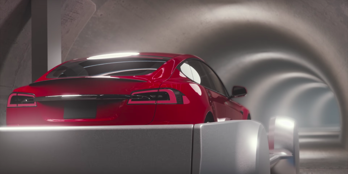 elon musk's boring company tunnel : tesla-like car on a skate in a tunnel under LA