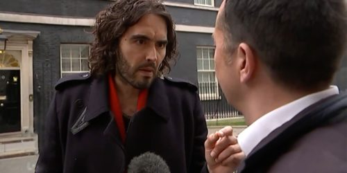 Russell Brand Speaks to Reporter