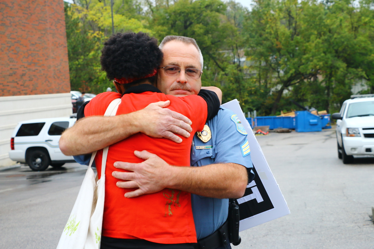 Ferguson October protester hugs police officer