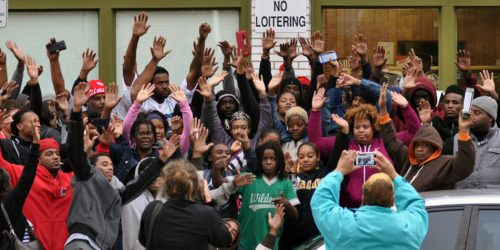 Protesters in Shaw Give the 'Hands Up Don't Shoot' Gesture
