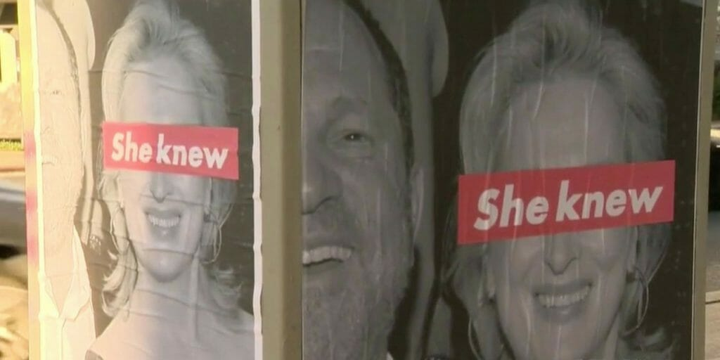 "Posters of Meryl Streep and Harvey Weinstein with the phrase ""she knew"" over Streep's eyes"