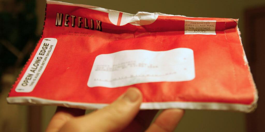 Man holding Netflix envelope