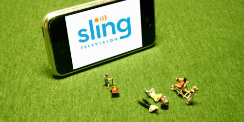 Miniature People Toys Watching Sling Television on Phone