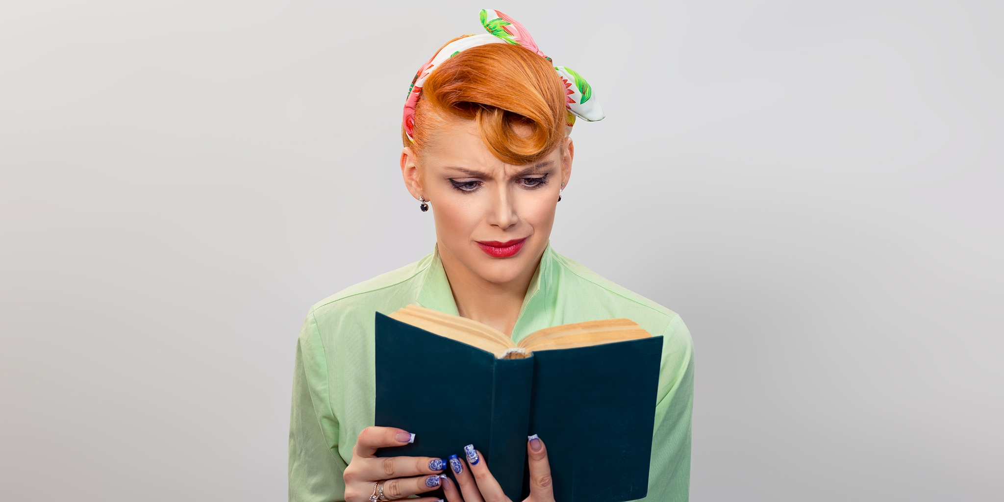 Woman not enjoying what she's reading