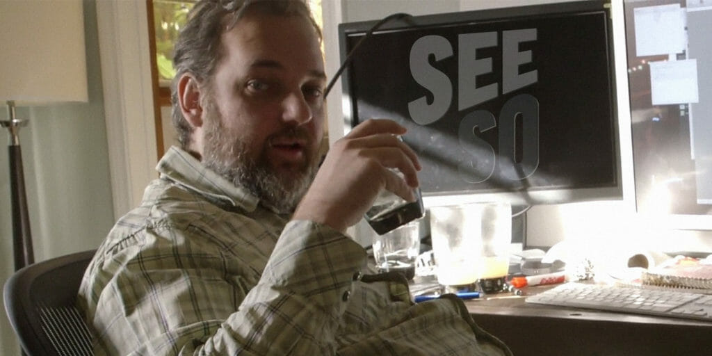 Dan Harmon with a See So logo on his monitor