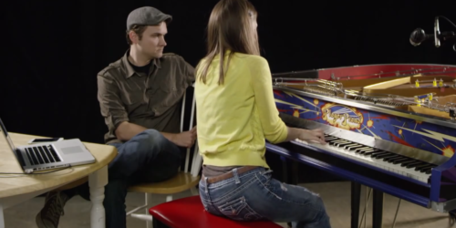 Man Watching a Woman Play Piano
