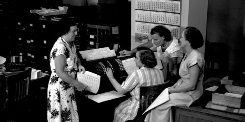 Women operators at Midvale Company payroll machine in Time Office