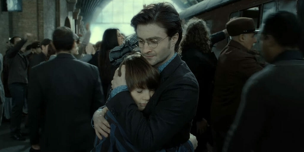 Harry Potter hugs Albus Severus Potter on his first day of Hogwarts
