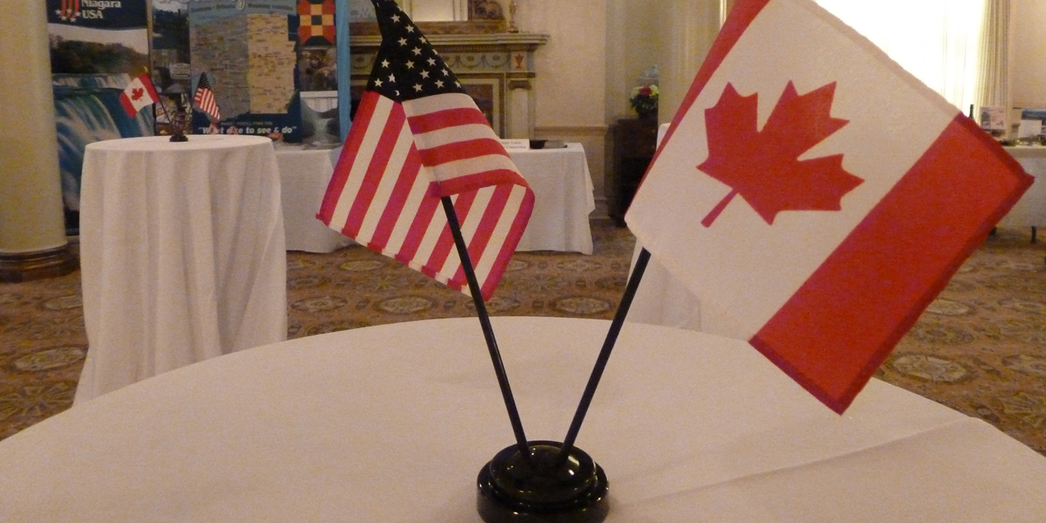 American and Canadian Miniature Flags on Table