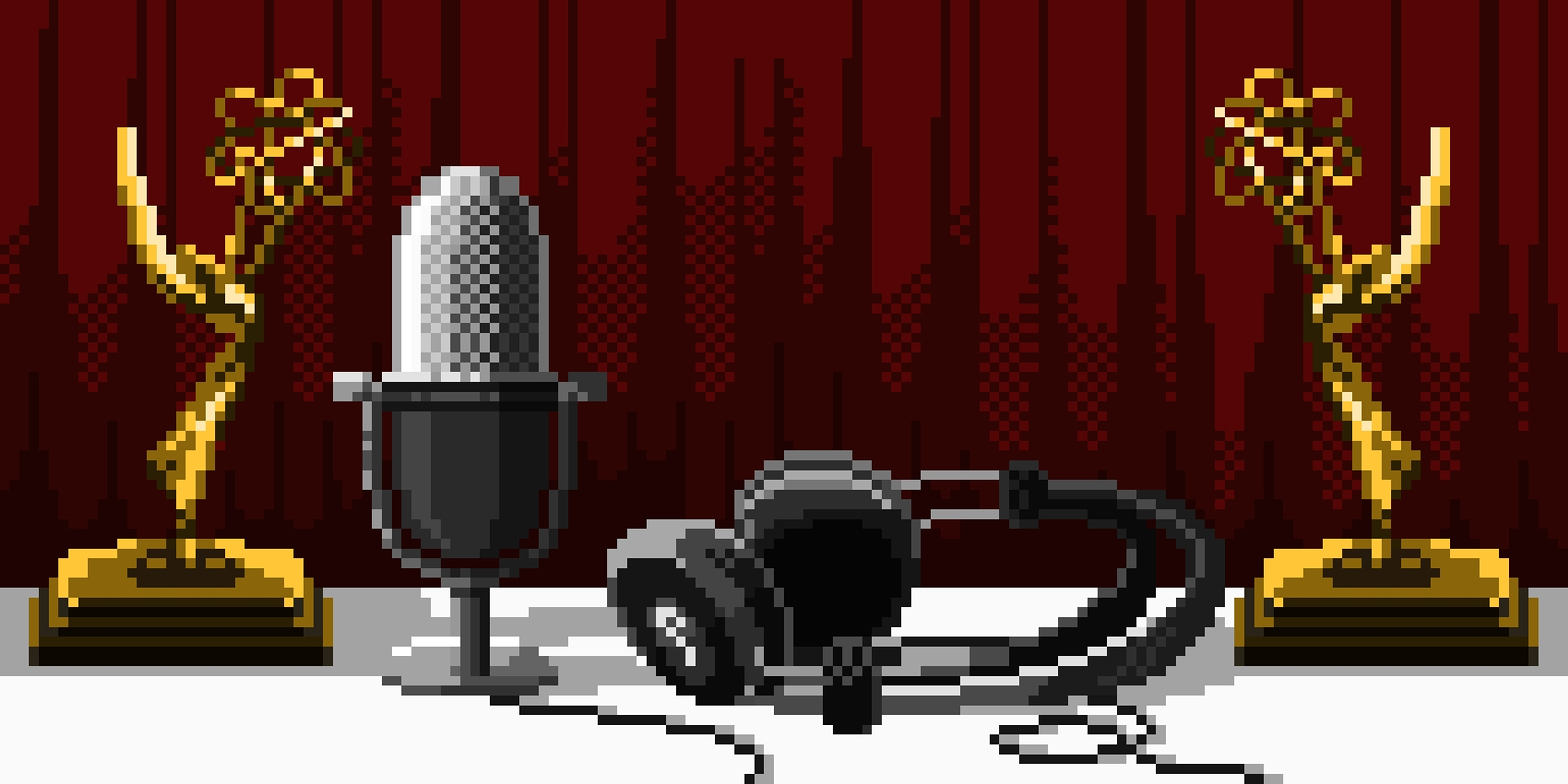 Emmy statues with microphone and headphones