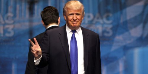 Donald Trump makes a peace sign at CPAC 2013