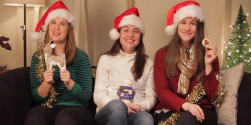 Girls Sitting On Couch In Christmas Hats