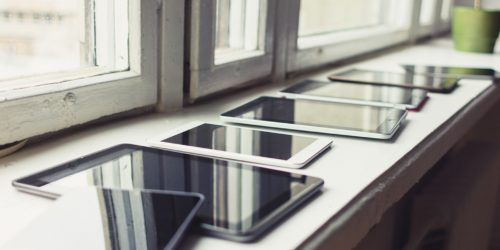 A Row of Tablets Laid out on a Windowsill