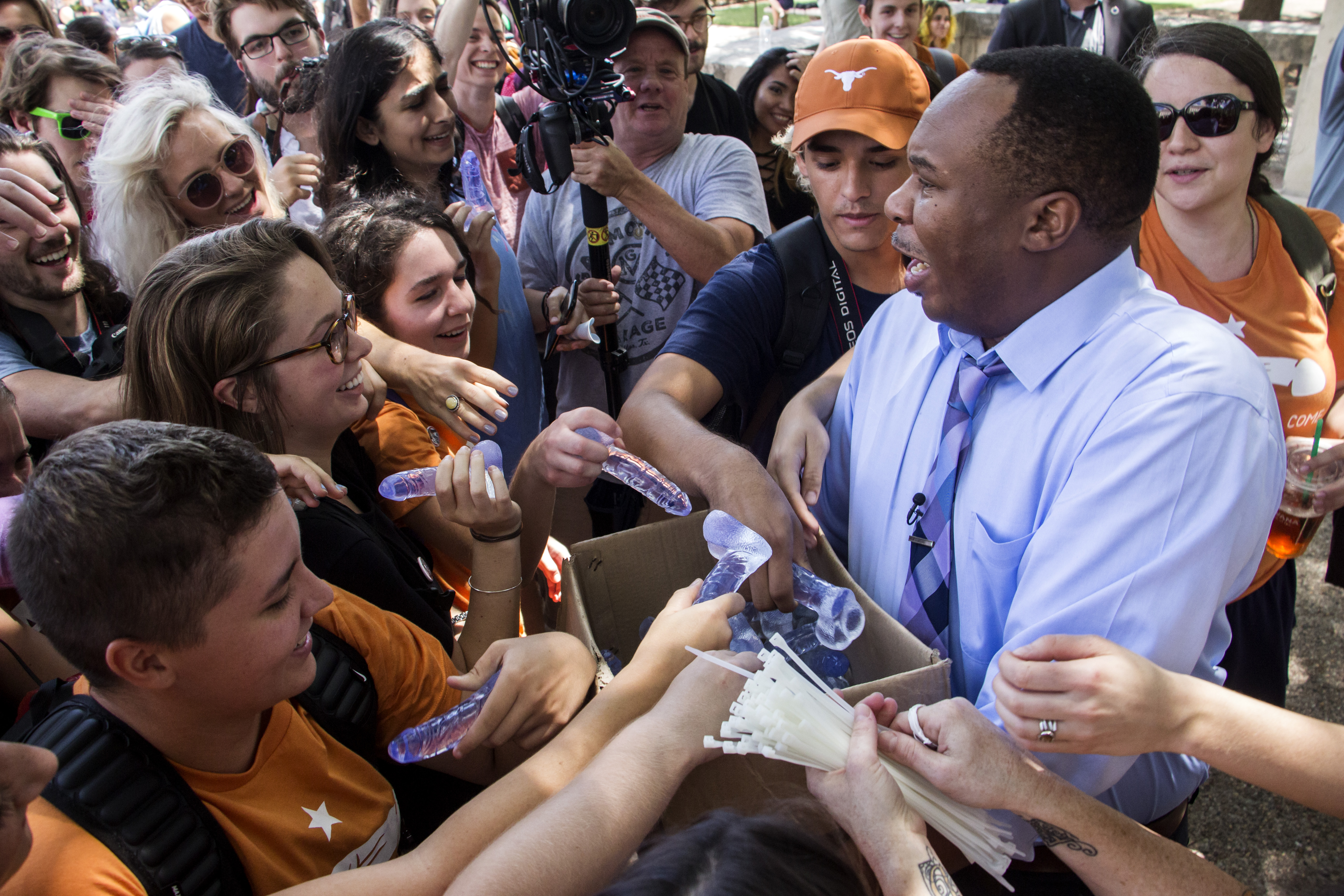 Roy Wood Jr. passes out dildos to University of Texas students.