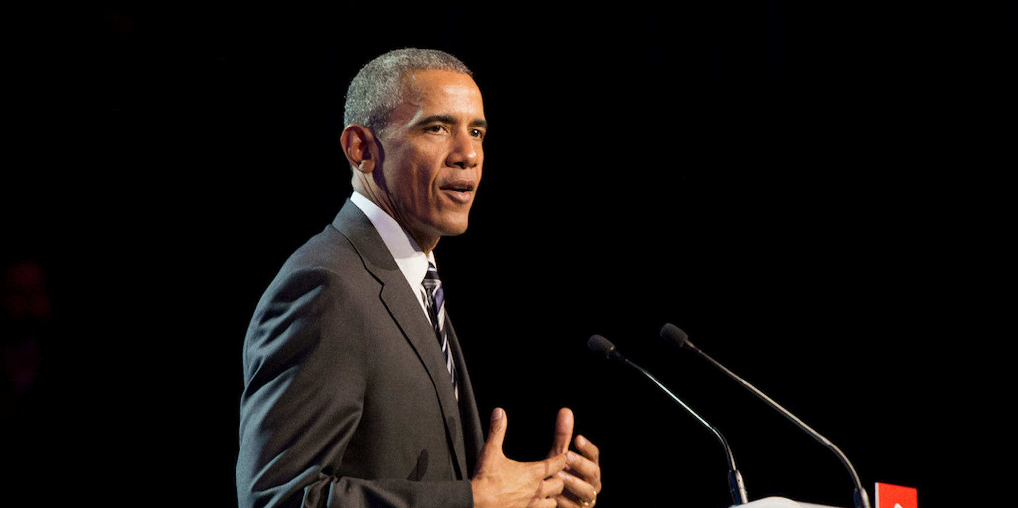 President Barack Obama speaking into a microphone.