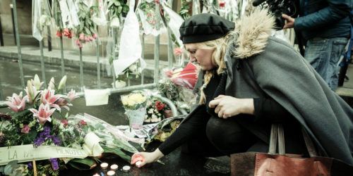 Woman Kneeling at a Memorial for Charlie Hebdo Victims